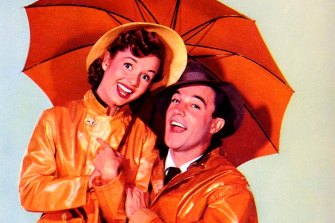 Debbie Reynolds and Gene Kelly in the iconic Singing in the Rain.