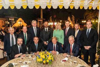 US President Trump hosted a working dinner for Brazilian President Jair Bolsonaro, at Mar-a-Lago last year. The Brazilian ambassador, Nestor Forster, standing behind Bolsonaro, then tested positive for coronavirus.