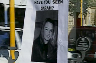 A missing person poster on the public phone booth where Sarah Spiers called for a taxi before she vanished.