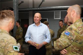 Peter Dutton met soldiers in Townsville last month.