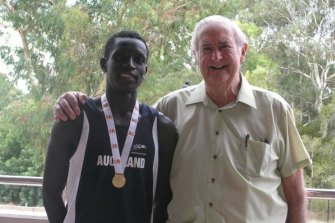 Peter Bol with Brian Moore, the father of his teacher Helen Leahy, who helped nurture his talent.
