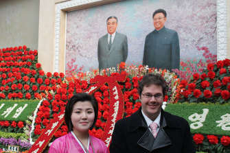 Michael Ruffles with a guide to a North Korean flower exhibition in 2012.