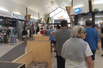 People in Dunsborough queue up for the pharmacy, despite the South West region not being subject to lockdown restrictions.