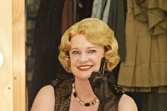 Helen Pitt tries out a wig for size for her walk on part in La Boheme.