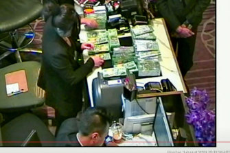 The NSW Bergin inquiry found that this footage of large amounts of cash being exchanged at Crown Melbourne was probably money laundering.