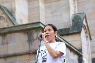 Myanmar-born Sydney businesswoman Sophia Sarkis addresses the 2000-strong crowd at the vigil on Saturday.