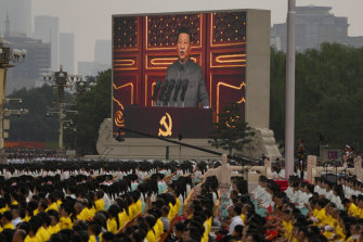 A screen shows Chinese President Xi Jinping speaking during a ceremony to mark the 100th anniversary of the founding of the Chinese Communist Party at Tiananmen Square in Beijing on Thursday.
