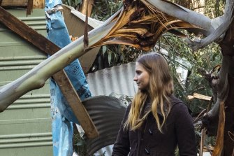 Michaela Pascoe surveys the damage at her bed and breakfast property in Mt Dandenong.