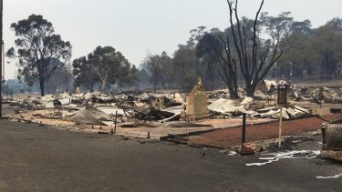 Close to 100 homes were destroyed by the flames.