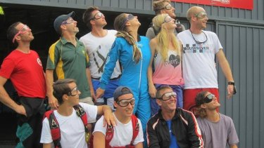 Alana Clarke, centre in blue, with her skydiving group just a day before the fatal accident.