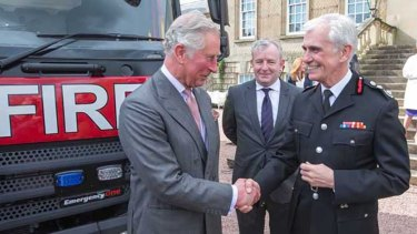 Former London Fire Brigade commissioner Ron Dobson, far right, with Prince Charles.