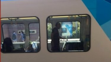 The unprovoked attack forced the city-bound train to stop at Hawthorn station.