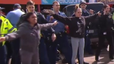Ms Garlett is joined by her mother between rioters and police in Kalgoorlie.