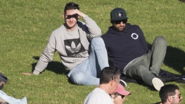 Back home: Former teammates Tim Moltzen and Benji Marshall watch from the hill.