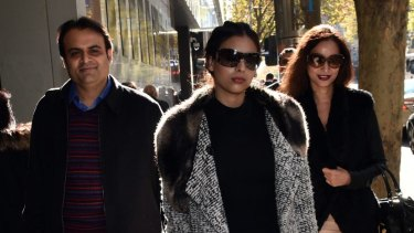 Pankaj Oswal (left) and his wife Radhika (right) and daughter leave court in Melbourne.