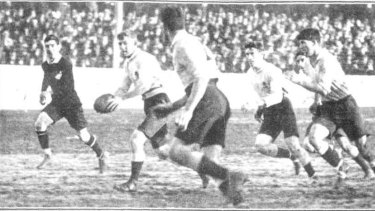 Diggers: The Waratahs' Herbert Jones passes to Clarence Wallach during a match against the All Blacks in 1914. Both were killed in World War I.