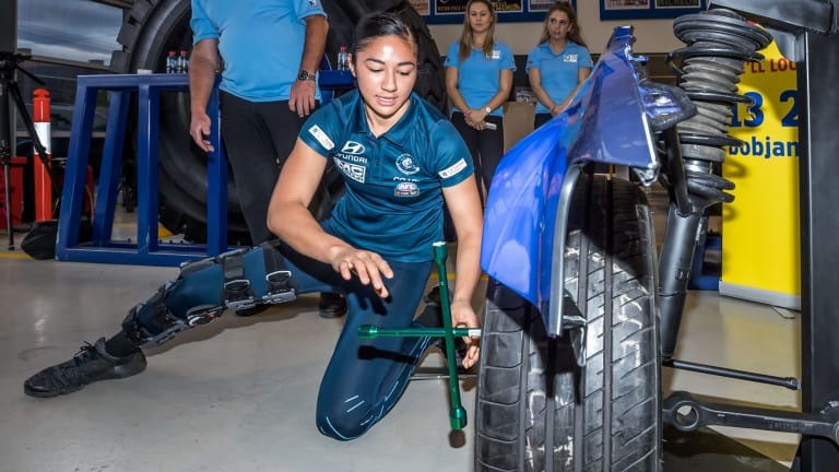 Darcy Vescio changing a tyre for the first time.