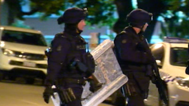 Police in full riot gear prepare to enter the Parkville youth centre.
