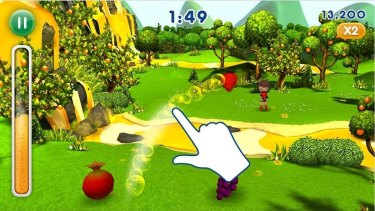 The Fanta Fruit Slam 2 app game displays the score as a thermometer of fizzy orange liquid.