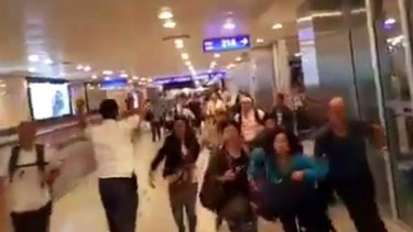 Travellers in airport fleeing the blasts, caught on CCTV.