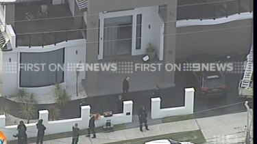 Police raiding properties in western Sydney on Wednesday morning.