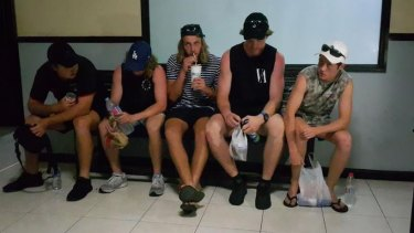 Friends of Jamie Murphy's await at the Kuta police station, Bali.