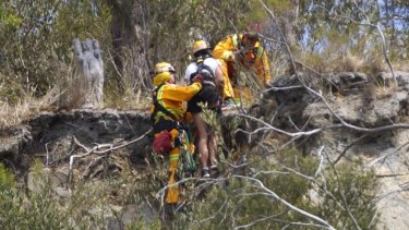 CFA members help the woman reach safety.