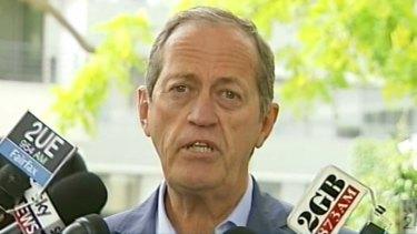 Australian team doctor Peter Brukner addresses the media on Wednesday.