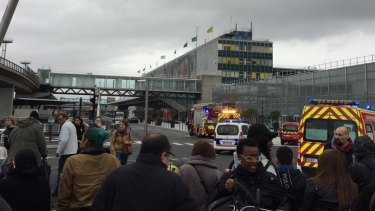 Passengers are evacuated from Orly airport in Paris after reports of shots fired.