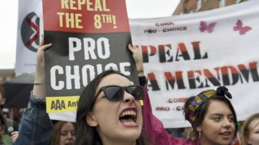 Demonstrators take part in a protest to urge the Irish Government to repeal the 8th amendment to the constitution, which enforces strict limitations to a woman's right to an abortion, in Dublin.