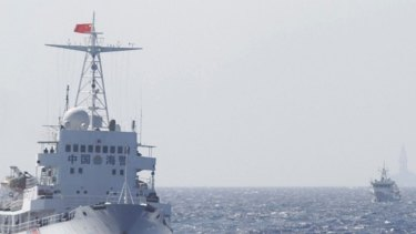 Ships of Chinese Coast Guard are seen near the Chinese oil rig Haiyang Shi You 981 in disputed waters in the South China Sea.