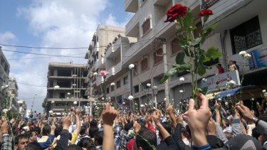 """""""Flowers were met with bullets, protesters were rounded up en masse and detained"""": A May 2011 demonstration in the coastal Syrian town of Baniyas."""