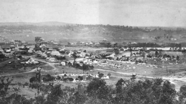 The cemetery is visible in the centre of this panoramic image of Brisbane taken from Enoggera Road in 1874.