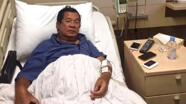 """Hun Sen lies in a hospital bed in Singapore in May where he said he was treated for """"extreme exhaustion""""."""