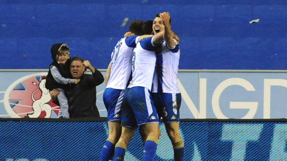 Magic moment: Will Grigg celebrates his goal.