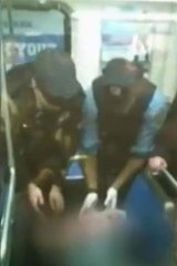 Police help deliver a baby on a Philadelphia subway train.