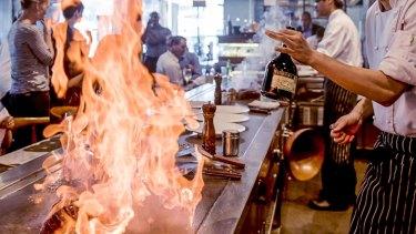 Teppanyaki restaurants feature chefs cooking at an open hot plate.
