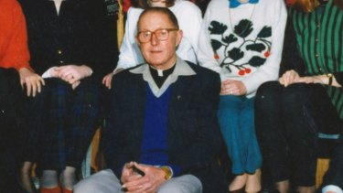 Father Peter Searson in a Doveton Holy Family Primary School staff photo from 1992.