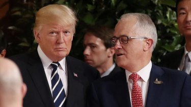 Prime Minister Malcolm Turnbull walks with US President Donald Trump at the G20.