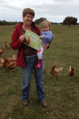 Free range egg producer Kathy Barrett from Katham Springs, pictured with her granddaughter, says the voices of smaller egg farmers are being drowned out by larger producers.