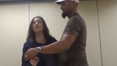 Hope Solo is consoled by her husband, Jerramy Stevens.