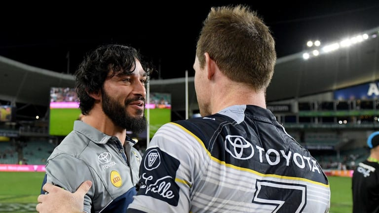 Master and apprentice: Jonathan Thurston congratulates the man who stepped into his massive boots, Michael Morgan, during last year's finals campaign.