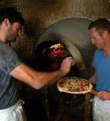 Di Mare ingredients: Napoli sauce, mozzarella, basil, prawn cutlets, scallops, olives, garlic, parsley.