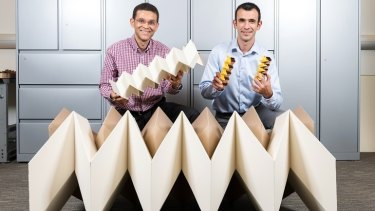 Glaucio Paulino (left) with Evgueni Filipov and their engineering origami prototypes.
