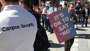 """Hundreds of counter-protesters gathered around a man encouraging Sydney University students to """"vote no"""" in the same-sex marriage postal vote."""