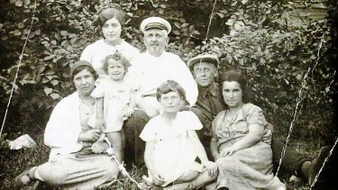 Yelena Kurchinsky (standing, front left) with her parents Vladimir and Hana (right), her sisters and her grandparents in Kiev in the northern summer of 1938.