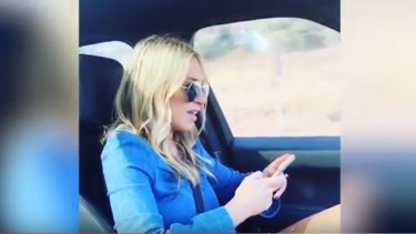 Sam Burgess' wife Phoebe sings along to Cold Chisel's <em>Khe Sanh</em> while the footballer films her apparently while he is driving.