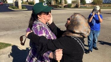 Cynthia DeBoutinkhar embraces an anti-Islam protester outside the Noor Islamic Cultural Center in Columbus, Ohio.
