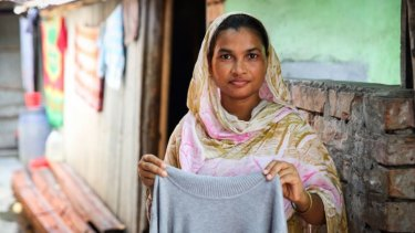 Garment worker Anju, who sews jumpers for 37¢ an hour in a factory in Bangladesh.