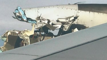 A photo of the damaged engine on Air France flight 66, which was en route to Los Angeles when pilots were forced to make an emergency landing in Canada. Photo was taken by passenger Rick Engebretsen